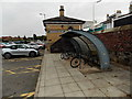 SJ3033 : Open-sided bicycle shelter outside Gobowen railway station by Jaggery