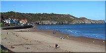 NZ8612 : The Sunday morning beach walk by Gordon Hatton