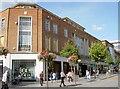 SX9292 : High Street shops by Neil Owen