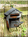 TM2297 : Disused letterbox by Evelyn Simak