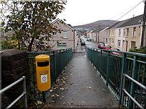 SS8591 : Yellow litter bin on a river footbridge in Maesteg by Jaggery