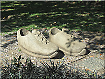 SK5319 : Wooden shoes in Queens Park by Thomas Nugent