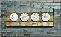 SK5319 : Pictograph mosaics by the canal basin by Thomas Nugent
