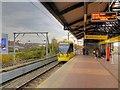 SJ8297 : Airport Tram Leaves Cornbrook by David Dixon