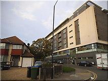TQ1986 : New block on the corner of Chalkhill Road by David Howard