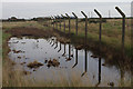 TM4348 : Derelict fence, Orford Ness by Ian Taylor
