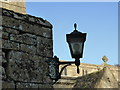 SK9716 : Church of St Mary: lamp at the gate by Bob Harvey