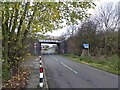 SK5088 : Disused mineral line bridge and bridleway sign by Steve  Fareham