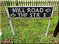 TM1979 : Mill Road & The Street signs by Geographer