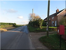 TF8707 : Station Road at Holme Hale by Peter Wood