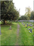 TM1579 : Footpath through St.Andrew's Churchyard by Adrian Cable