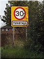 TM3555 : Tunstall Village Name sign by Adrian Cable