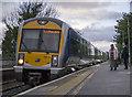 J4882 : Train, Carnalea Station by Rossographer