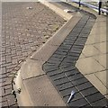 SP3379 : Kerb and paving, bus stand V, Pool Meadow bus station, Coventry by Robin Stott
