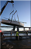 NT1278 : Lifting a Yacht by Anne Burgess
