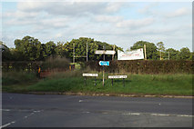 SP0575 : Road signs at Forhill with Woodrush Rugby Club ground beyond by Robin Stott