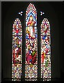 NY2225 : Stained glass window above the altar, Thornthwaite Church by Graham Robson
