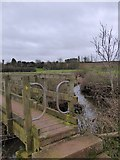 SX9797 : Footbridge over stream near Broadclyst by David Smith
