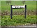 TL1957 : Potton Road sign by Adrian Cable
