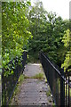 NY7962 : River Allen: defunct footbridge at Plankey Mill by Christopher Hilton