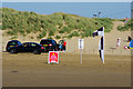 SD2912 : Cars and RNLI flags on the beach at Ainsdale by Phil Champion
