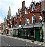 SY6990 : South Street shops and a church, Dorchester by Jaggery