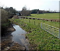 SS9077 : Field gates and a pipeline at the edge of  the Ewenny River, Ewenny by Jaggery