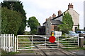 SE1890 : Level crossing gate at Finghall Lane Station by Roger Templeman