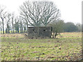 TM1487 : WW2 hexagonal pillbox on Gissing Common by Adrian S Pye