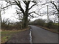 TL6003 : Fingrith Hall Lane & footpath by Adrian Cable