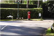 SU9667 : Postbox and signpost on West Drive by Shazz