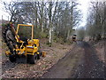NY6757 : Laying fibre-optic cable beside trackbed of Alston Railway, Bowden's Banks by Andrew Curtis