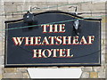 NY9864 : Sign for The Wheatsheaf Hotel, St. Helen's Street, NE45 by Mike Quinn