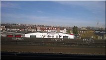TQ2572 : Industry and housing by the Wandle, Earlsfield, from the railway by Christopher Hilton