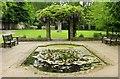 SZ1692 : Ornamental pond by Christchurch Priory by Steve Daniels