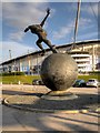 SJ8698 : Commonwealth Games Statue and Stadium by David Dixon