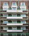 TQ2781 : Windows, Balconies & Pale Green Pipes by Des Blenkinsopp