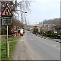 SO6554 : Oncoming vehicles in middle of road sign, Bromyard by Jaggery