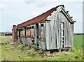 SK6673 : Old railway carriage now a derelict shell by Chris Morgan