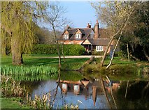 SU9890 : House reflected in Layters Gren Pond by Bikeboy