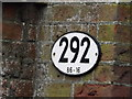 TM0567 : Bridge Number on the Pound Hill Railway Bridge by Adrian Cable
