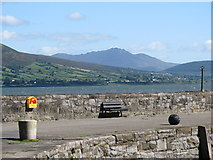 J1811 : The northern breakwater at Carlingford with its view of Slieve Binnian by Eric Jones