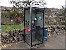 NY9038 : Phone box and litter bin by Ayre