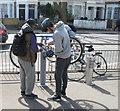 TQ2180 : Cyclists use public repair stand by David Hawgood