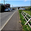SN6215 : Wonky fence at the edge of Kings Road, Llandybie by Jaggery