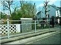 TQ2490 : Dollis Road and stream by Clint Mann