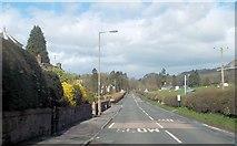 NS5579 : Straight road through Strathblane by John Firth