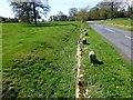 NZ0882 : Ha ha beside road by Russel Wills