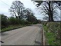 NZ1894 : Minor road towards Causey Park Bridge by JThomas