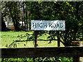 TM2784 : High Road sign by Adrian Cable